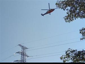梅州首用直升�C巡查���路���a缺陷提效率