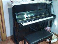 出售9成新珠江立式钢琴一架